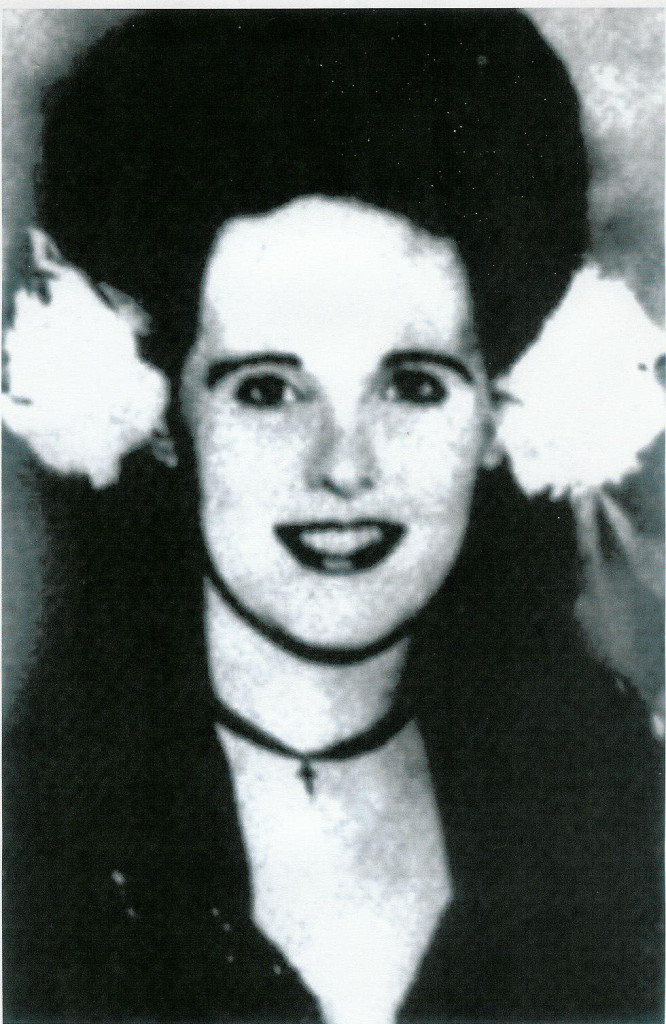 ELIZABETH SHORT, WEARING FLOWERS IN HER JET-BLACK HAIR, AS WAS HER TRADEMARK